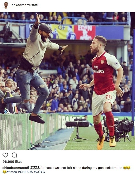 Shkodran Mustafi and Arsenal fan celebrate offside goal v Chelsea