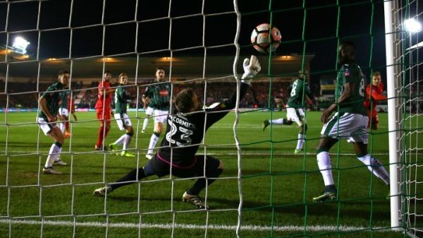 Rare Lucas goal sees Klopp's men through