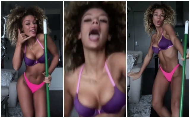 Jena Frumes has some solo fun without Jesse Lingard as Manchester United WAG performs in her underwear while singing into a mop