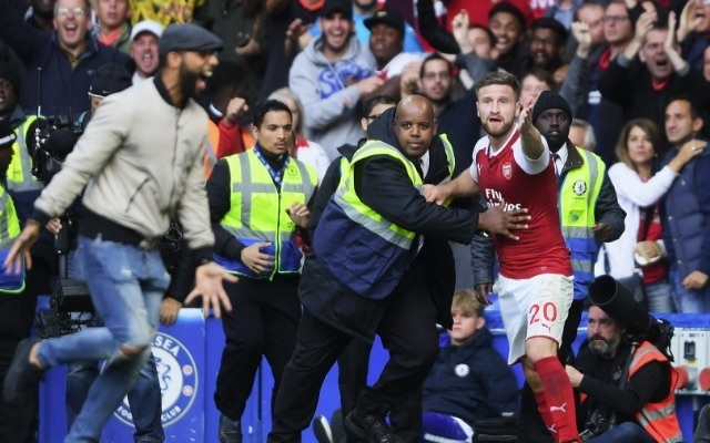 (Photo) Arsenal fan ejected from Stamford Bridge for invading pitch to celebrate offside Shkodran Mustafi 'goal' v Chelsea